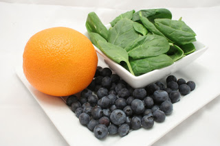 orange, spinach, and blueberry twist